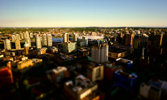 Vancouver City Miniature (TOTORORO.RORO) Tags: life travel light sunset sky canada color reflection tourism window glass colors skyline vancouver buildings reflections lens observation landscape living landscapes miniature downtown bc view zoom britishcolumbia sony wideangle tourist deck highrise handheld through alpha popular visitor viewing f4 attractions birdseye nationalgeographic harbourcentre oss tiltshift nex 360degree vancouverlookout harbourcentretower greatervancouver mirrorless topofvancouver topofvancouverrevolvingrestaurant 1018mm nex6 sel1018