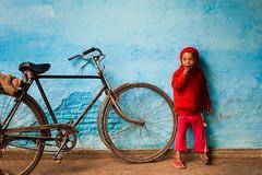 (Rakesh JV) Tags: street blue red india color wonder photography kid child indian north joy streetphotography happiness cycle frame varanasi amazement framing soulful rakesh cwc uttarpradesh bluebackground nikond800 chennaiweekendclickers rakeshjvphotography rjvphotography