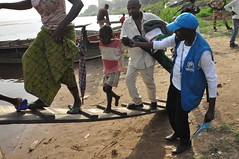 Central African Republic: Crossing the Oubangui to Home and Safety (UNHCR) Tags: family girl car river boat refugees staff help aid protection assistance unhcr drc centralafricanrepublic oubanguiriver unrefugeeagency voluntaryrepatriation unitednationsrefugeeagency humanitarianworkers congoleserefugees