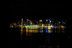 Floating, sparkling jewels in the night (peggyhr) Tags: blue friends red orange white canada black green yellow skyline night vancouver reflections lights bc harmony seabus finegold thegalaxy 50faves peggyhr heartawards flickrawardgroup slicesoftime thebestshot ringexcellence thegalaxyhalloffame redgroupno1 yellowgroupno2 greengroupno3 niceasitgets~level1 musictomyeyes~l1 wondersoftheworldhistoricalvaluables ♣myhatsofftoyou ♣scapes p1070108a