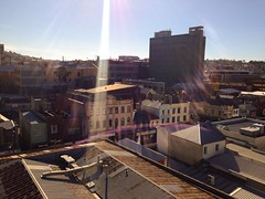 the things we can't see (keith midson) Tags: city rooftops flare tasmania hobart streetscape sunray