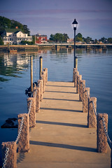 Private Dock (tdalpert) Tags: light sunset dock post none glowing lantern posts
