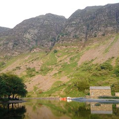 Reflection on possible danger (gowersaint) Tags: britain europe uk cumbria wasdale fells mountains rock geology geological county countryside rural water lake reflections evening summer rescue people men boat van buildings weather