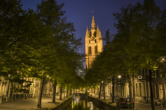 20160619_F0001: The Old John is looking down (wfxue) Tags: road street city longexposure bridge houses light sky reflection tree tower church water netherlands bike night evening canal delft tilt leaning oudekerk tilting oudejan