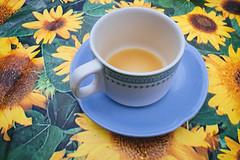 Tea (Matthew-King) Tags: tea cup sunflower table cloth blue saucer white