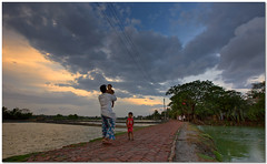 father's day out (Soumya Bandyopadhyay) Tags: sunset colors rural children landscape village dusk father wide perspective son bengal westbengal clours canon1635mmf28lii canoneos5dmk3