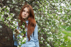 Gorelochk (Serge Zap) Tags: woman outdoor young girl beauty beautiful spring park adult blossom female tree white people smile portrait branch hair blooming model redhead summer caucasian lady lifestyle nature cute person pretty natural green flower freedom season garden harmony apple attractive face fresh long look relax freckles freshness candid happy emotional blue bokeh