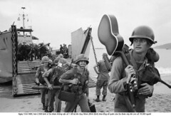 BE054283 (ngao5) Tags: sea people men beach water soldier coast outfit clothing war uniform asia southeastasia ship guitar military group helmet vietnam pacificocean transportation americans males whites anticipation musicalinstrument adults landingcraft watercraft warship southchinasea armedforces carrying acousticguitar headgear stringedinstrument chinasea westpacificocean northpacificocean militarypersonnel militaryuniform quinhon militaryvessel unitedstatescavalry binhdinhprovince southcentralcoastregion