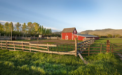 Sunrise Barn (tomkellyphoto) Tags: trees sky usa grass barn rural sunrise fence dawn utah spring ut quiet farm horizon barns scenic peaceful farmland fencing oakley springtime