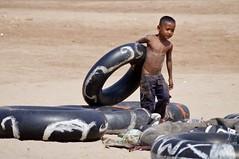 le de la soie 2 (luco*) Tags: boy river de island la cambodge cambodia little silk ile tire enfant soie mekong pneu phnom penh fleuve mkong