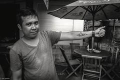 The Tattoo Artist of Bali (Hadi Zaher) Tags: people bali beach tattoo indonesia funny artist story arab temporary humans jimbaran anecdote