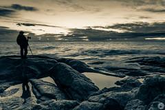 Tell Me What You See (karolmaza) Tags: sea bw white man black reflection water silhouette sepia clouds skyscraper sunrise landscape rocks silueta reflejos photooftheday