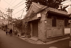 """China Beijing hutong backalley with old-school structures and wires - """"Hutong Style"""" (moreska) Tags: china urban blackandwhite monochrome sepia architecture corner slick vines asia afternoon fifties backalley rooftops outdoor gray beijing structures kingdom retro wires alleyway 1950s hutong middle hazy stark sings drizzle placards"""