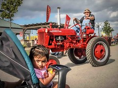 Hey lady, hold up with that stroller... (Wes Iversen) Tags: people men kids illinois farmers parades vehicles antiques tractors strollers cornonthecob hcs grayslake lakecountyfair babystrollers photobomb clichesaturday nikkor18300mmfairs