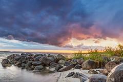 Thunderclouds in Denmark (bhansen.kiel) Tags: sunset sun seascape storm color green wet water rain clouds canon landscape denmark dramatic wolken balticsea sunrays landschaft thunder