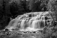 Bond Falls in B&W (Images by MK) Tags: trees blackandwhite bw water up flow outdoors waterfall rocks outdoor michigan falls waterfalls upperpeninsula cascade bondfalls capturedwater