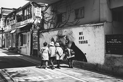 Streets Of Bukchon: Energetic And Healthy Old Ladies! (Wing Yau Au Yeong) Tags: old friends cane walking graffiti healthy women young streetphotography walkingstick seoul kr southkorea outing 2016 hunched energetic hijing bukchon