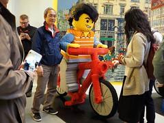 Lego cyclist - red bike (AMcUK) Tags: bike bicycle copenhagen denmark lego bikes olympus bicycles cycle micro minifig cph omd m43 em10 maxifig 43rds micro43 olympusuk olympusem10
