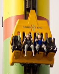 Fear Fall 03 (C & R Driver-Burgess) Tags: park family friends boy woman man tower girl sisters fun amusement high rainbow dad sitting lift ride fairground brothers father elevator mother daughters pole pylon mum together theme colourful held tight harness sons strapped