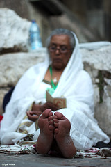 untitled (koala-x) Tags: portrait people woman holiday church canon 50mm israel jerusalem prayer jesus ceremony middleeast gimp christianity  churchoftheholysepulchre  pilgrim jesuschrist ethiopian 60d canon60d