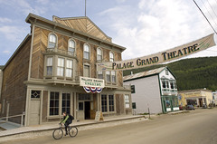 Palace Grand Theatre (Pat Kane Photo) Tags: road city woman bicycle gold site theatre north grand palace historic dirt yukon rush dawson klondike northerncanada