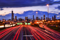 Feel the Rhythm & Flow of Chicago! (TIA International Photography) Tags: county travel blue light sunset urban chicago building tower lamp skyline clouds skyscraper tia john landscape concrete flow evening illinois spring highway midwest stream long exposure downtown traffic motorway loop dusk district sears south central cook business trail lamppost 94 rush hour commute metropolis cbd interstate expressway hancock trump 90 prudential willis rhythm tosin springtime lanes arasi tiascapes tiainternationalphotography