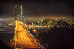 Into Town (Allard Schager) Tags: sf sanfrancisco california city longexposure nightphotography bridge usa mist fog skyline architecture america 1936 spring nikon downtown skyscrapers nightshot unitedstatesofamerica towers landmark icon illuminated le baybridge bayarea april vista sanfranciscobay curve curved amerika lente iconic span westbound californie vantagepoint interstate80 yerbabuenaisland tollbridge sanfranciscooaklandbaybridge 2013 d700 enfuse nikond700 nikkor2470mmf28 nikonfx allardone allard1 baylights allardschagercom