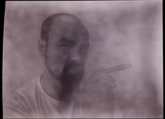 . (tsiklonaut) Tags: portrait bw white abstract man black art film look analog painting 3d haze weed inch paint smoke cuba fine tube creative large cigar smoking format 100 analogue asa smoky unreal ideal hazy cuban cinematic tobacco joint sigar 5x7 efke 11000 drumscan  pmt   goerz teie  dagor syrreal    kahjustab tervist   syrrealism  tubakas pl100m scanview scanmate suitsetamine  photomultiplier