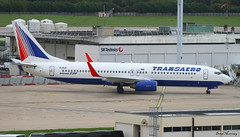 Transaero 737-800 EI-RUE (birrlad) Tags: morning sunlight paris france reflection glass airplane airport ramp glare russia terrace moscow taxi aircraft aviation airplanes jet terminal apron airline boeing arrival airways airlines russian runway viewing landed orly airliner 737 arriving taxiway 737800 transaero vision:text=0838 vision:beach=0626