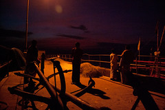 Untitled (Life in Frozen Frames) Tags: light shadow sky people india yellow halogen bengal diamondharbour fishharbour lifeinfrozenframes reemagill tamaghnasarkar 20131122dsc1724