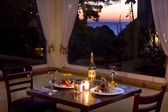 Rita Crane Photography:  Dining for Two by the Sea at Greenwood Pier Inn (Rita Crane Photography) Tags: northerncalifornia evening highwayone wine explore romantic dining elk oceanview tablesetting pacificcoast mendocinocoast tablefortwo stockphotography elkcalifornia greenwoodpierinn wwwritacranestudiocom ritacranephotograhy