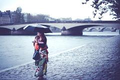 It Doesn't Matter If It Rains (Rasmus Hartikainen) Tags: people paris rain seine umbrella river nikon colorful clothes d800 sigma50mmf14