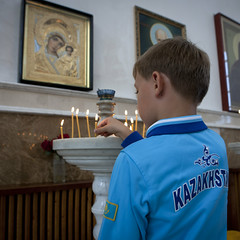 Boy Praying In A Russian Orthodox Church, Astana, Kazakhstan (Eric Lafforgue Photography) Tags: boy people childhood youth standing square religious person icons candle interior faith capital religion pray belief christian indoors frame innocence inside spirituality tradition virginmary centralasia orthodox kazakhstan kazakh humanbeing tracksuit easterneurope astana orthodoxchurch fullback waistup squarepicture akmola akmolinsk kz4263