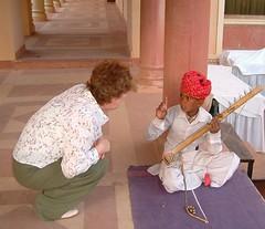 Instrument seller Jodhpur (tedesco57) Tags: musician india child instrument strings local seller jodhpur