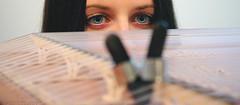 Staring at the picks (Geo.M) Tags: bridge blue music girl beautiful lady canon eos eyes traditional rita indoors rings musical instrument shooting 1855mm efs picks georgios kanun γέφυρα 700d παραδοσιακό γεώργιοσ miliokas μηλιώκασ όργανο κανονάκι πένεσ μουσικό δακτυλήθρεσ