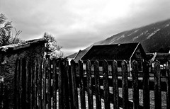 Ghost town (svatava_teflov) Tags: camera wood old trees winter blackandwhite bw cloud mountain black mountains alps cold building tree nature weather clouds canon fence buildings dark austria town wooden grim ghost bad noflash oldhouse woodenfence ghosttown bandw hdr badweather clou oldfence canoncamera