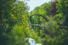 Rakotzbrcke (Kalbsroulade) Tags: bridge trees nature water canon 50mm see spring pond natur 50mm14 brcke teich tarn bume springtime frhling tmpel steinbrcke rakotzbrcke