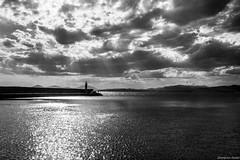 (Georgina ) Tags: sea sky blackandwhite lighthouse seascape mountains water monochrome silhouette clouds pier athens greece sunrays