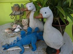 Distant Relations (prima seadiva) Tags: table found dinosaur may ducks porch cherub mygarden thrifted jurplasticpark