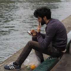 Facing canal (lgh75) Tags: man paris water eau sitting fumeur smoker canalstmartin assis homme theparisphotographymeetupgroup
