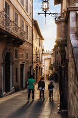 ancient lane (R. Welch) Tags: travel light shadow summer people urban italy history architecture buildings religious ancient europe italia medieval historic summertime assisi ancienttown italianhilltoptown