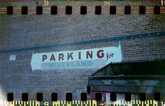 (Smiley Kailee) Tags: film dumpster 35mm vintage holga lomo lomography holes exposed sprockets