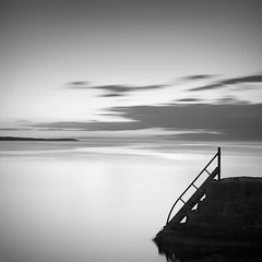 Last Light Plays on the Sea (panfot_O (Bernd Walz)) Tags: longexposure light sea blackandwhite bw seascape water monochrome square evening coast dusk fineart peaceful tranquility balticsea minimal shore silence zen minimalism bornholm waterscape ndfilter bathingjetty caalm