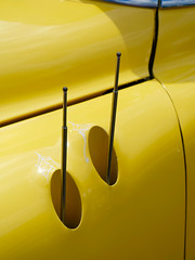 Slick antennas on classic car (mrgraphic2) Tags: classic car yellow antennas