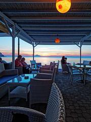 Sunset (Blue Waves Cafe Bar - Myrina Town - Lemnos Greece) Olympus OMD EM5II (markdbaynham) Tags: island greek north aegean hellas evil olympus greece grecia gr zuiko omd csc oly mz limnos hellenic m43 zd mft lemnos myrina mirrorless micro43 mzuiko m43rd em5ii zuikolic