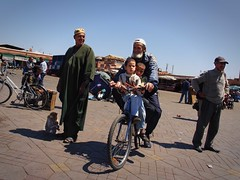 Father with kids on a bicycle (BenoitDemers) Tags: africa arab arabic architecture bargain berber business busy center city colorful crowd crowded cultural culture dealer el entertainer famous fna food foodmarket heritage holiday jemaa journey marrakech marrakesh medina moroccan morocco oriental people place sell square tourism tourist touristic town traditional travel unesco father kids bicycle cambodge