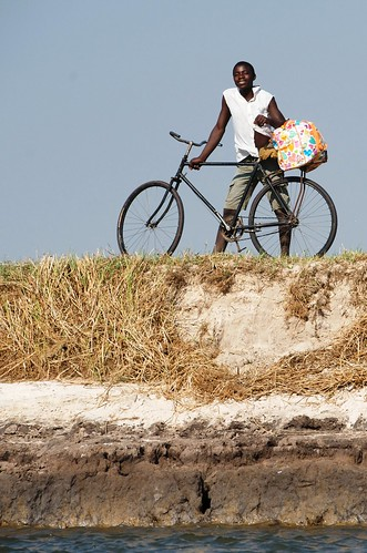 A man with a bicycle, Zambia. Photo by Patrick Dugan, 2012.