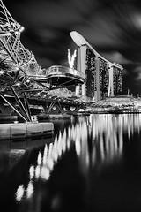 (Sunrider007) Tags: city bridge sea urban bw white black reflection water monochrome architecture night marina river lights hotel evening bay twilight singapore cityscape harbour estuary helix sands