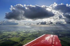 Flying the Yak 52 (ErikBrouwer) Tags: yak sky sun snow rain weather clouds airplane flying skies aircraft aviation military sony flight wing sigma thunderstorm russian aviator pilot trainer 52 yakovlev 19mm a6000