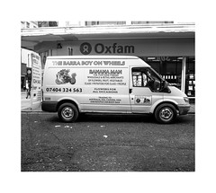 Oxfam and the barra boy.... (bevscwelsh) Tags: street liverpool oxfamshop panasonic14mm olympusem5 thebarraboy
